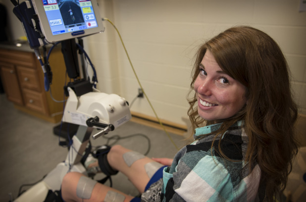 Amanda Timm, 21, was paralysed from the waist down after a skiing accident four years ago, but is now able to cycle again using the FES bicycle at her school, the University of Calgary. Photo: Jennifer Friesen / For Metro