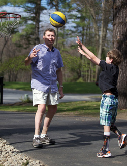David Misener CPO, plays basketball with his son Ethan. Both wear orthotic devices for CMT. Photo David Misener.