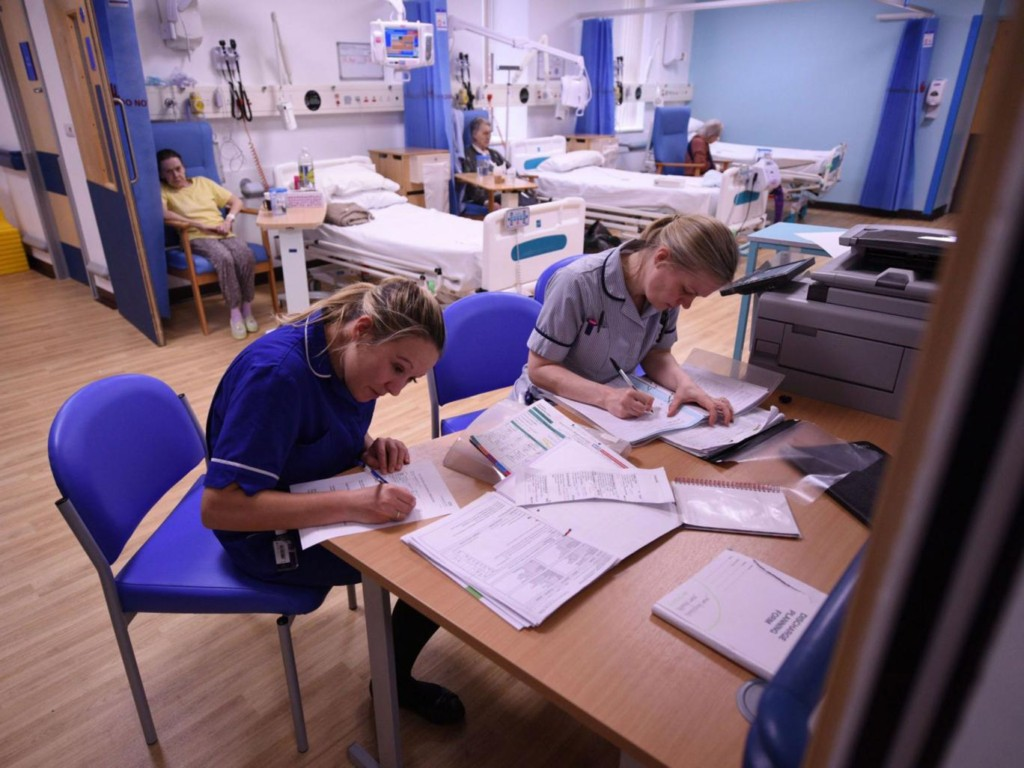 Members of clinical staff complete paperwork in the Accident and Emergency department of the 'Royal Albert Edward Infirmary' in Wigan, Lancashire UK. Photo Getty.