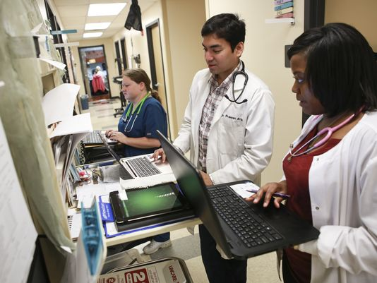 Bullitt County (KY) Medical Center medical assistant Shannon Britenfield, left, physician Praveen Arla and assistant intern Dominique Rhynes enter patient data into the EHR system at the Hillview, Ky. family practitioners office. Photo: Alton Strupp, Special to USA Today.