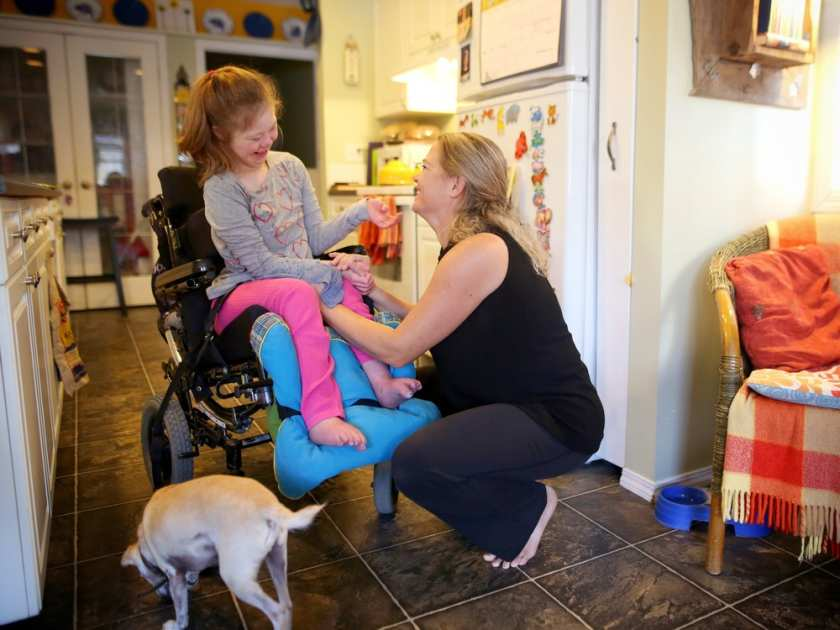 Holding hands and interacting with her loved ones is another way Emily enjoys spending time. Leah Hennel, Calgary Herald.
