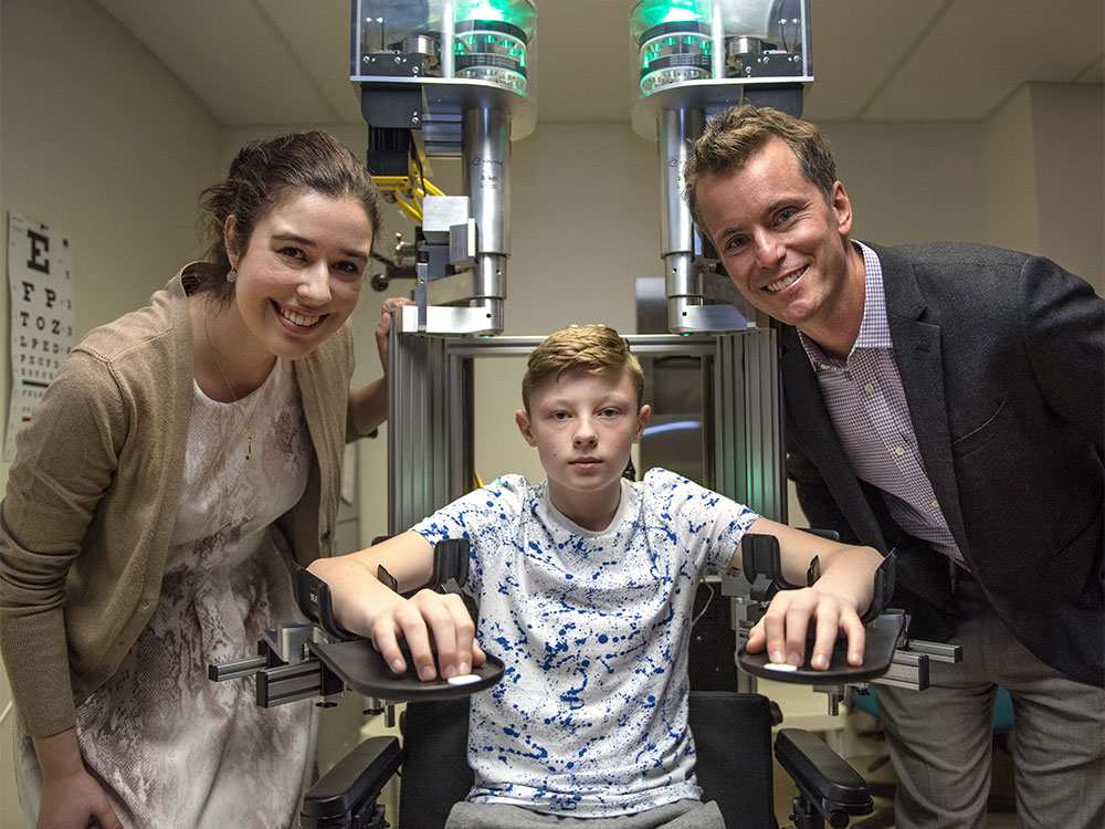 Max Challoner, 12, demonstrates the KINARM robotic device at the Foothills Medical Centre in Calgary on Monday, April 4, 2016. Researchers Andrea Kuczynski and Dr. Adam Kirton helped develop the device which measures proprioception, the ability to know where your limbs are in space. Elizabeth Cameron photo, Postmedia.