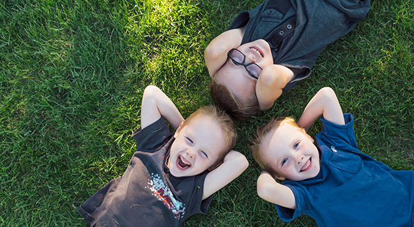 LOOK AT THEM NOW: The Ennis triplets (clockwise from bottom left), Ryan, David and Liam, have a lot to smile about. All three are healthy and happy six year olds thanks to research.