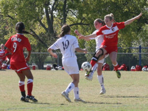 Former Dallas Texans player Christina Gordon (wearing brace) gave up club soccer after breaking her femur and tearing the ACL in both knees over a three-year span with the Texans.