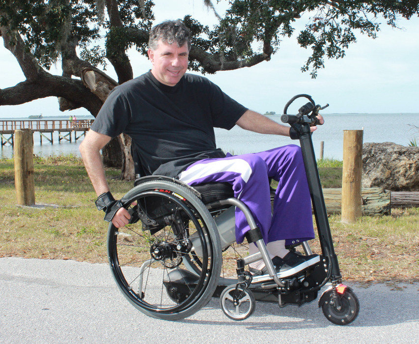 Pop 'n Drop bracket/scooter system attaches to any manual wheelchair.