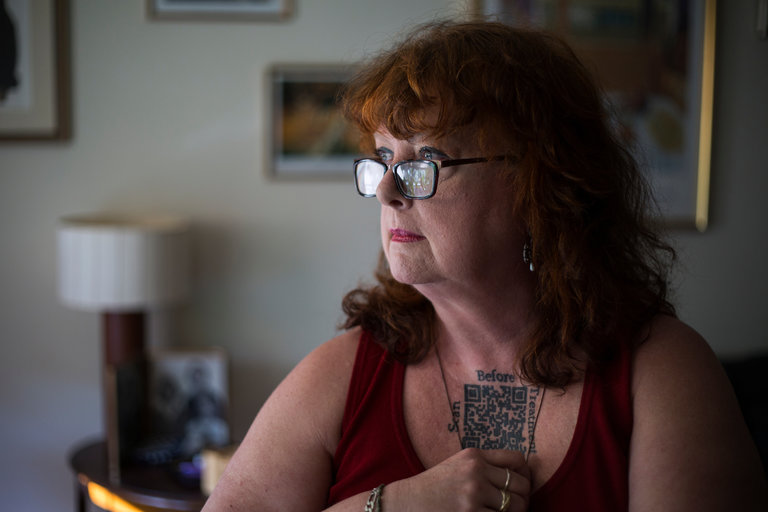 Casey Quinlan is a patient advocate who has a tattoo of a QR code — a type of bar code to store and track data — for her medical records. Credit Chet Strange for The New York Times.