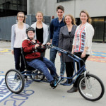 Queen's engineering students develop bicycle for teen with cerebral palsy